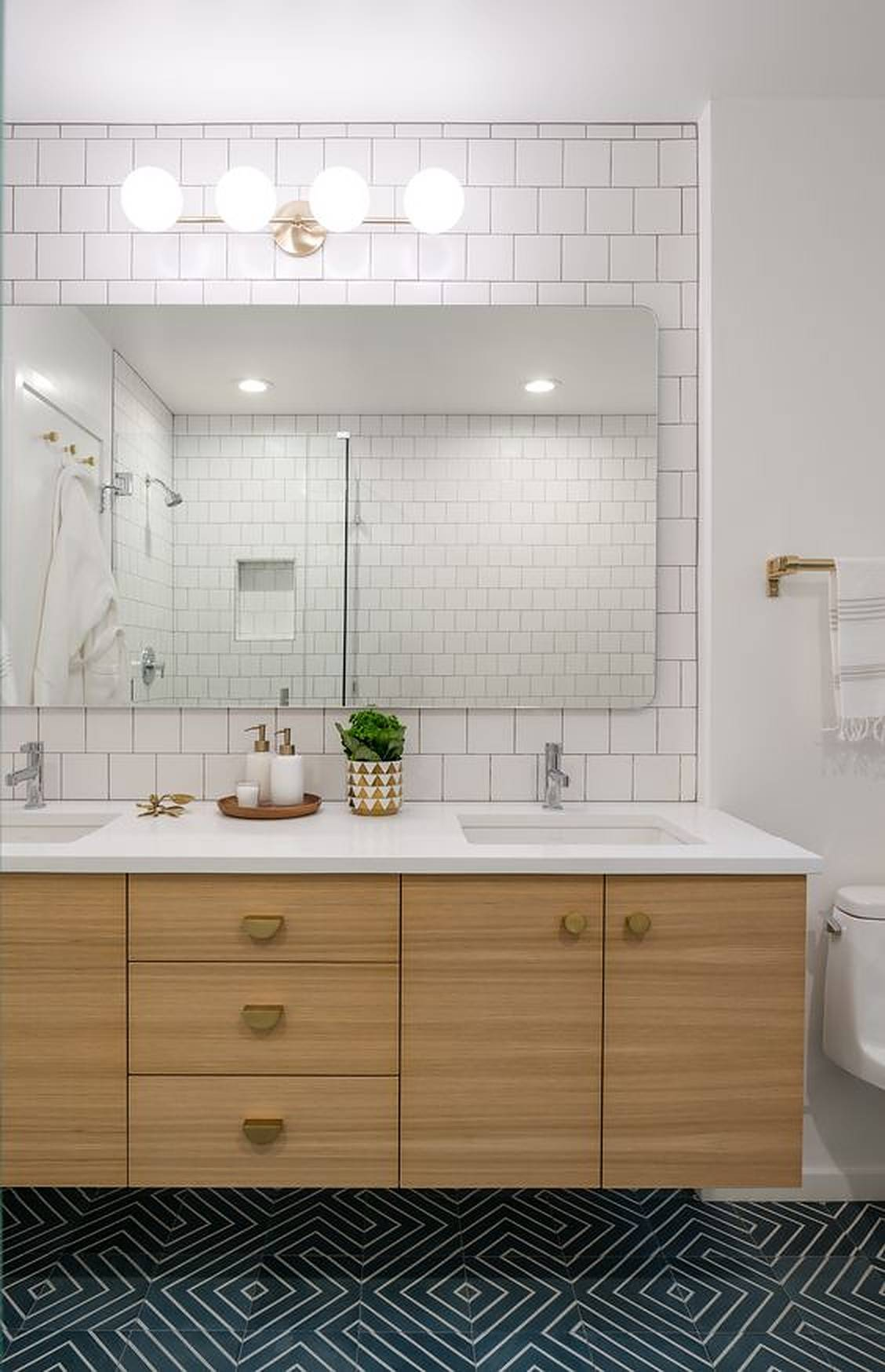 Double bathroom sink with green plant