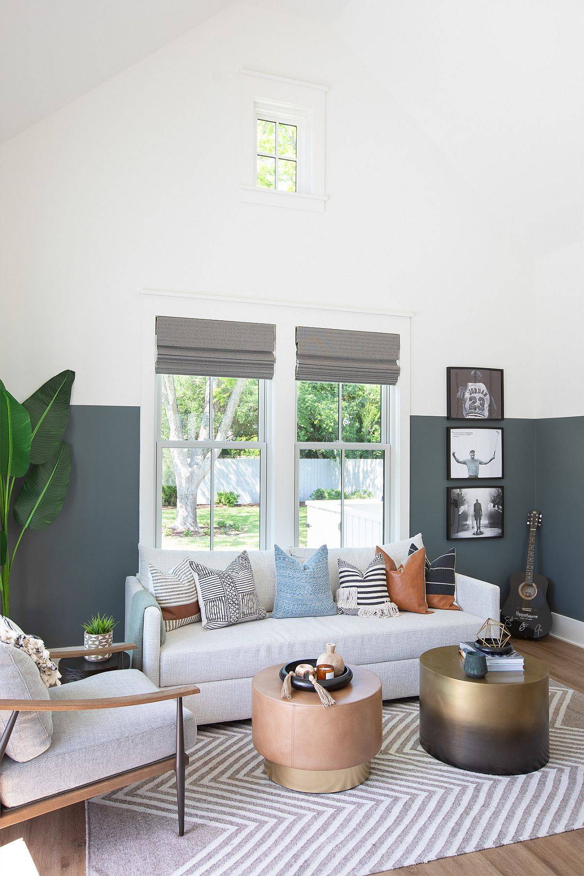 Double-height-family-room-in-gray-and-white-with-slanted-ceiling-and-color-scheme-in-gray-and-white-87757