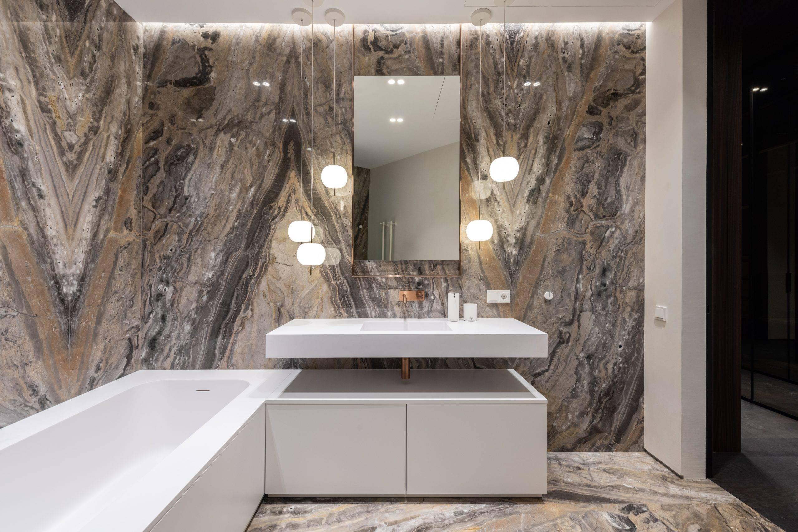 Elegant bathroom with white tub and sink