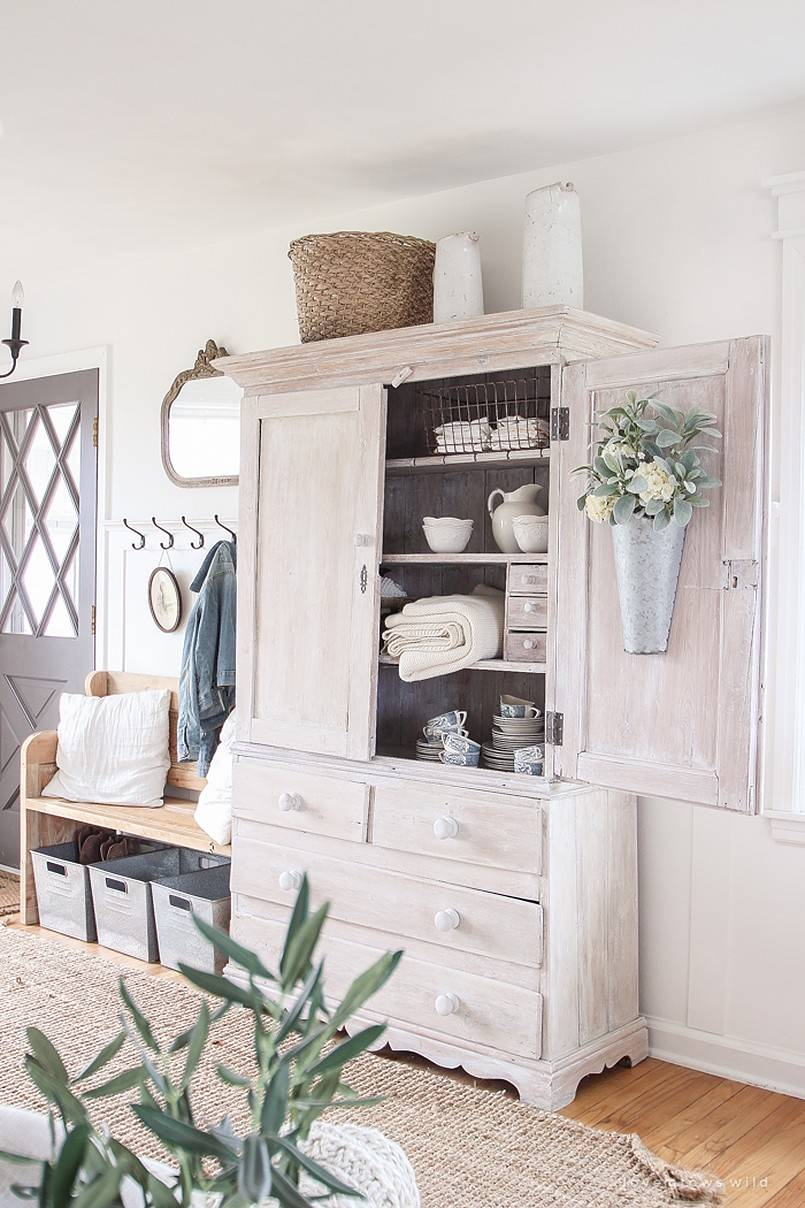 Entryway with cabinet and bench