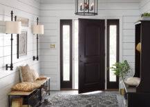 Entryway with open black door