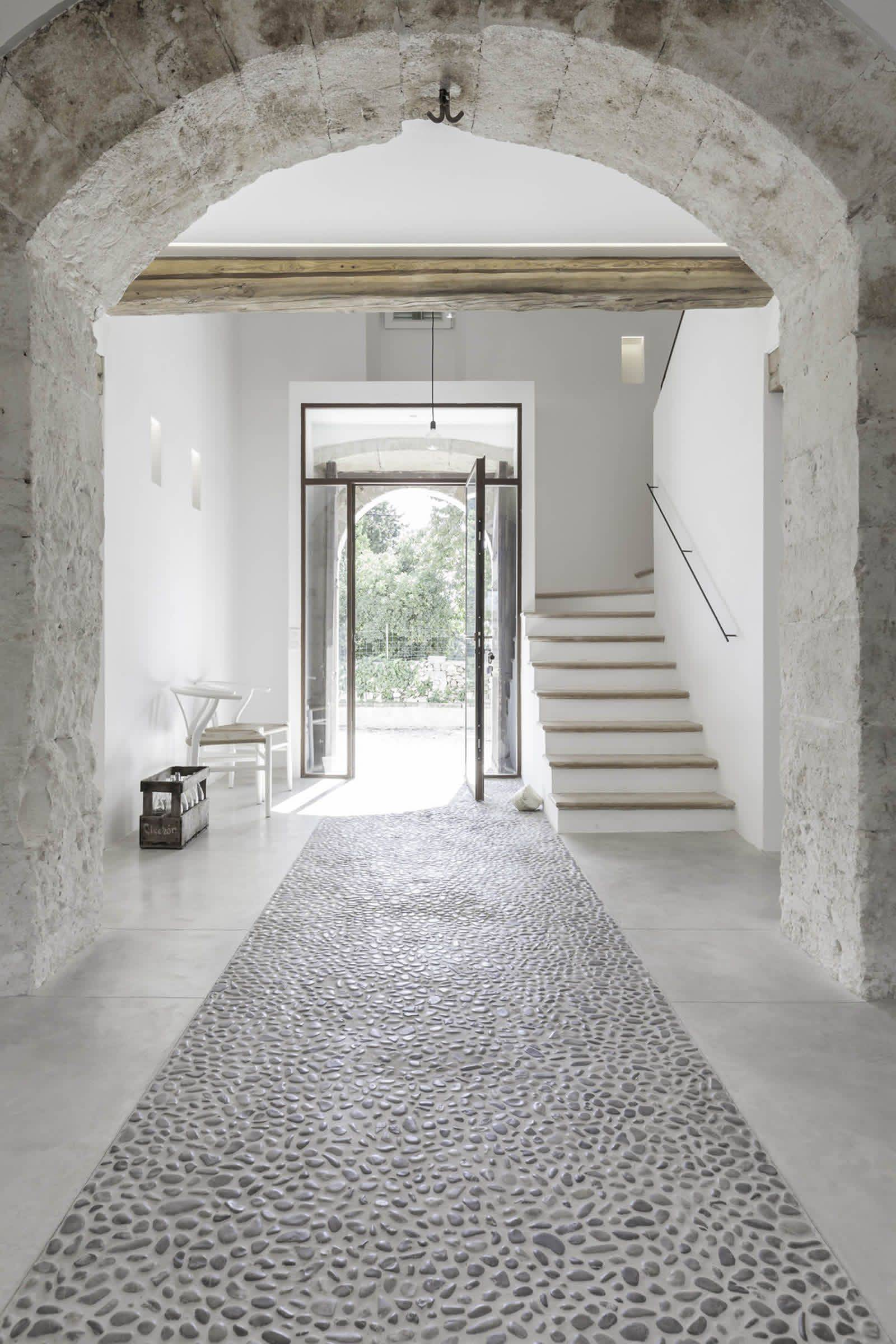 Entryway with pebbled stone floor