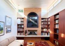 Family-room-with-brick-walls-large-bookshelves-and-clerestory-windows-that-usher-in-natural-light-19344-217x155