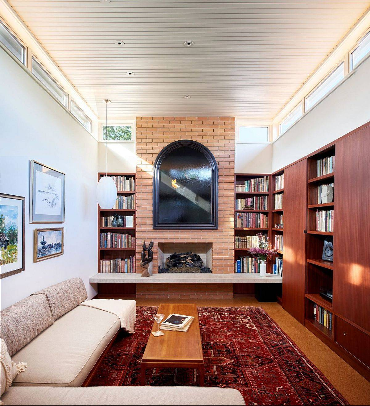 Family-room-with-brick-walls-large-bookshelves-and-clerestory-windows-that-usher-in-natural-light-19344