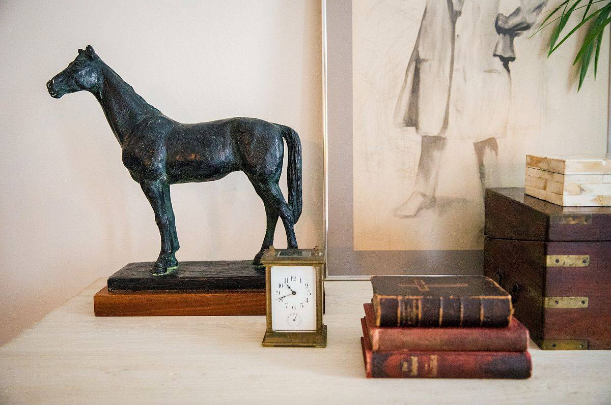 Finding vintage decorative pieces for the small bedside table inside the industrial bedroom