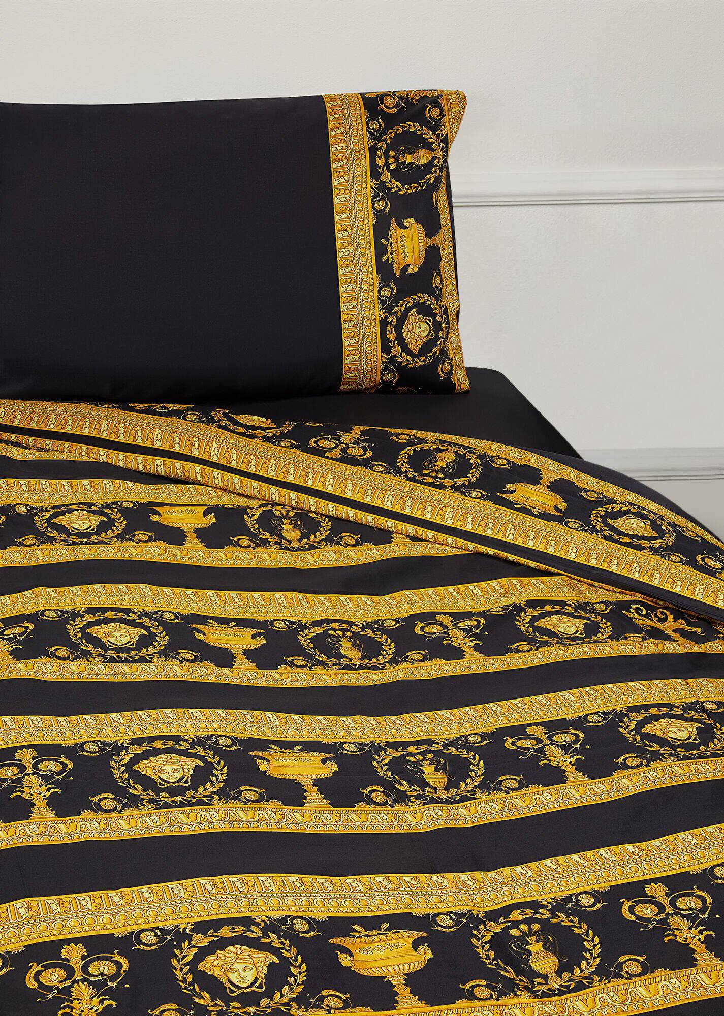 Gold and black bed sheets and pillow case