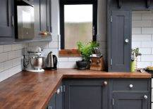 Gray kitchen cabinets and butcher block countertop