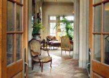 Hallway with a chair and stone flooring