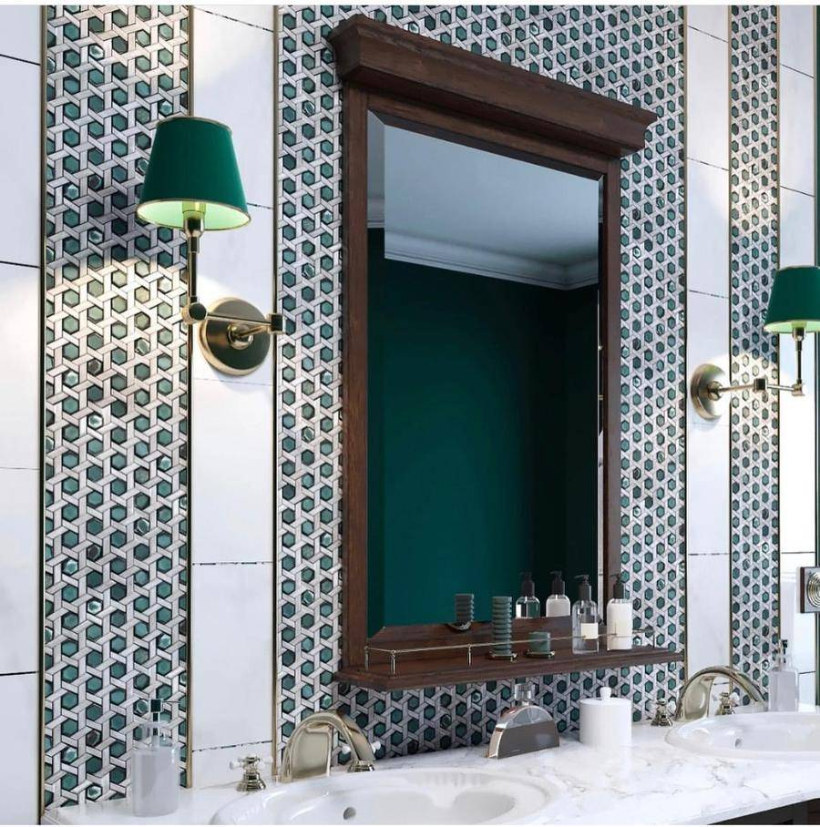 Large mirror in between green wall lamps