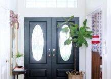 Large plant beside black double doors