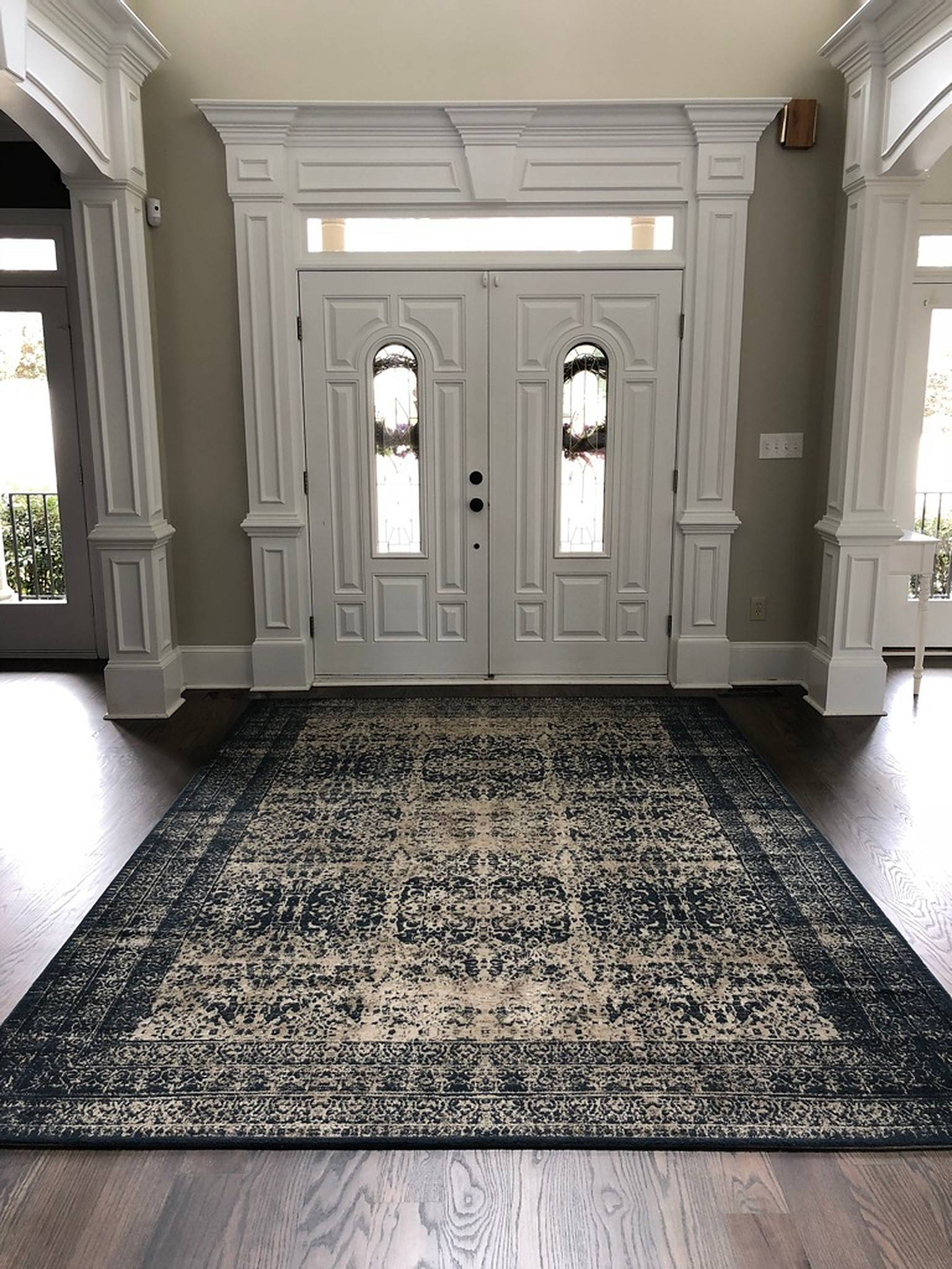 Large rug by front door entrance