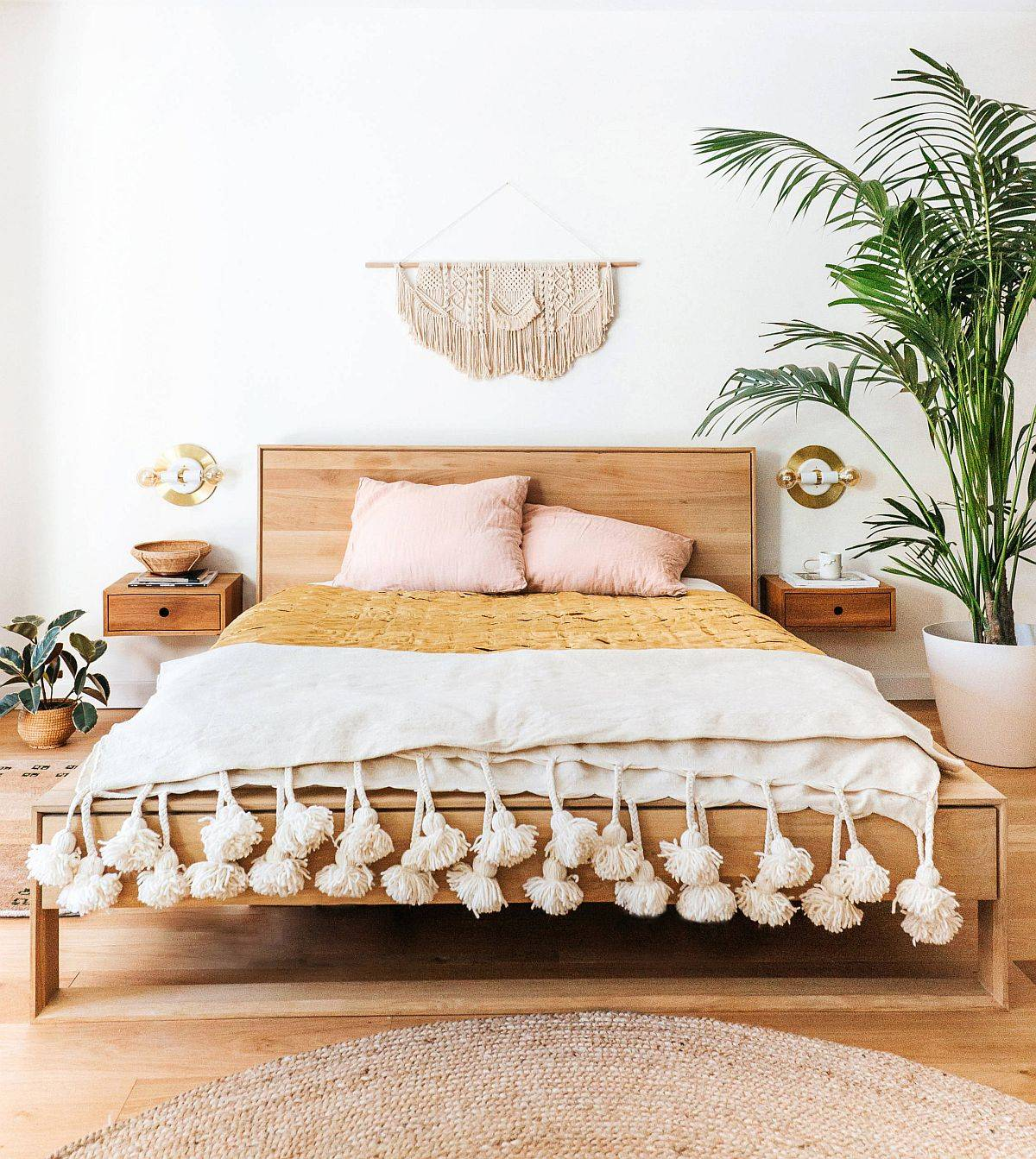 Light wooden floor and natural textures create a lovely, cozy and casual modern bedroom
