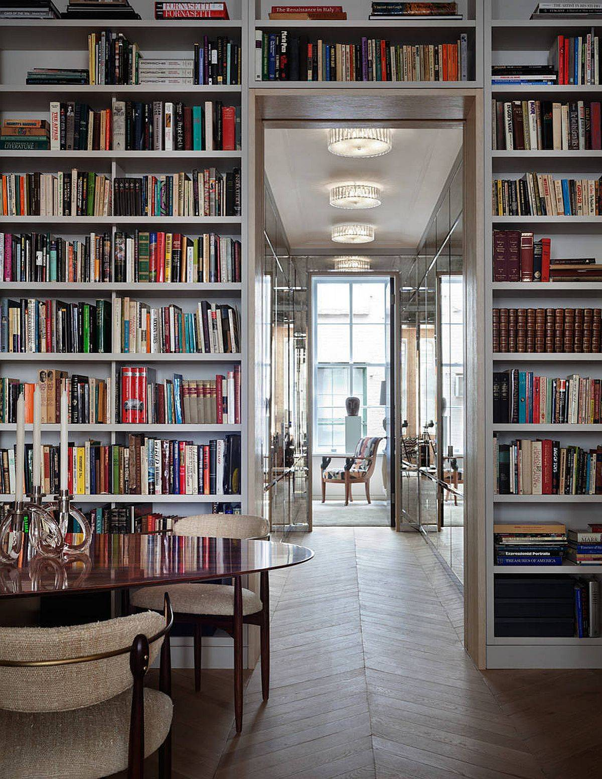 Lighting-mirrors-and-the-floor-to-ceiling-bookshelves-create-a-dramatic-New-York-home-40379