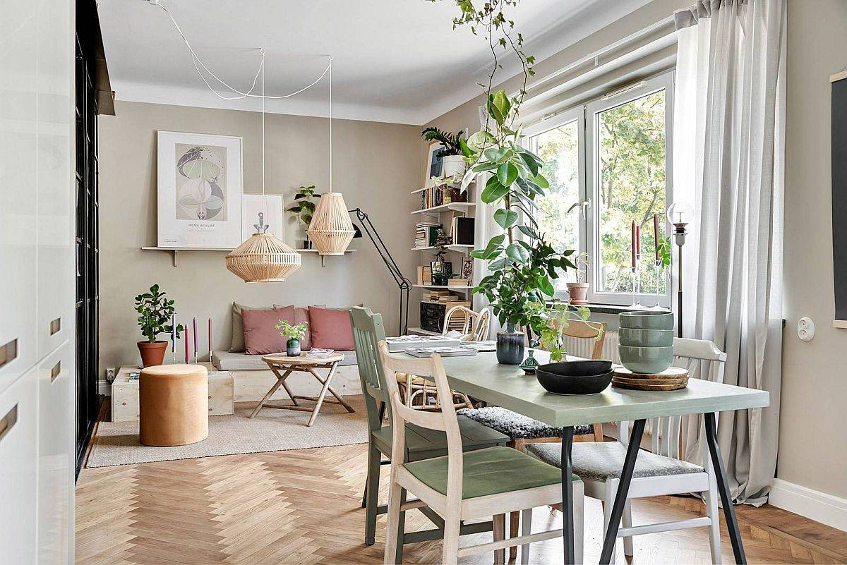 Living area and dining room find common style in this Stockholm apartment