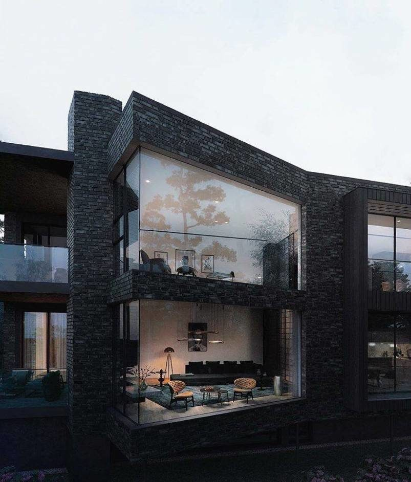 Living room visible through glass wall of a black house
