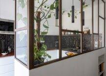 Low-wall-coupled-with-L-shaped-glass-partition-for-the-kitchen-and-dining-area-15057-217x155