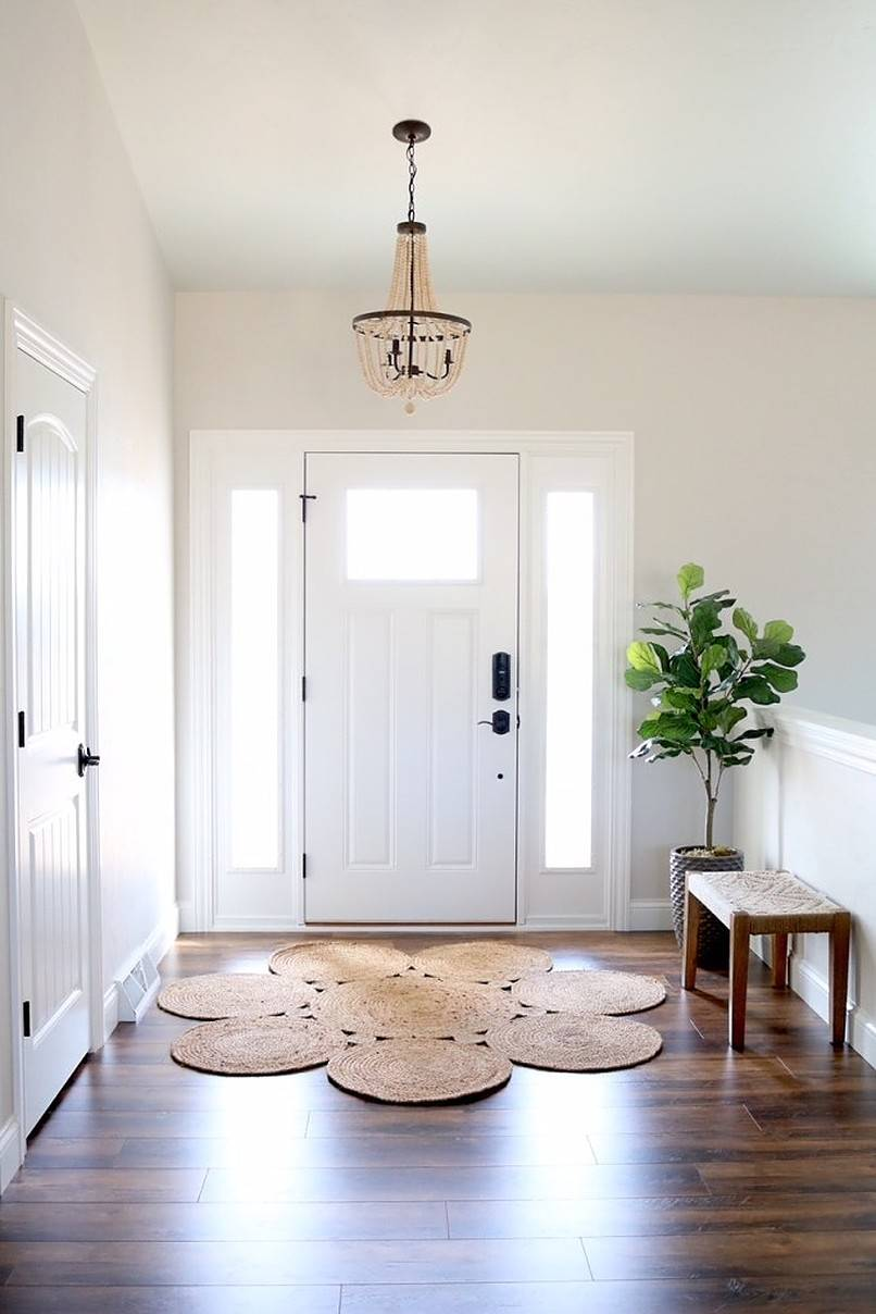 Minimalist foyer with bench and potted plant