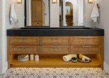 Modern bathroom sink with wooden drawers