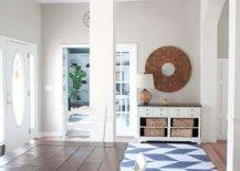 Modern foyer with printed rug and round wall deco
