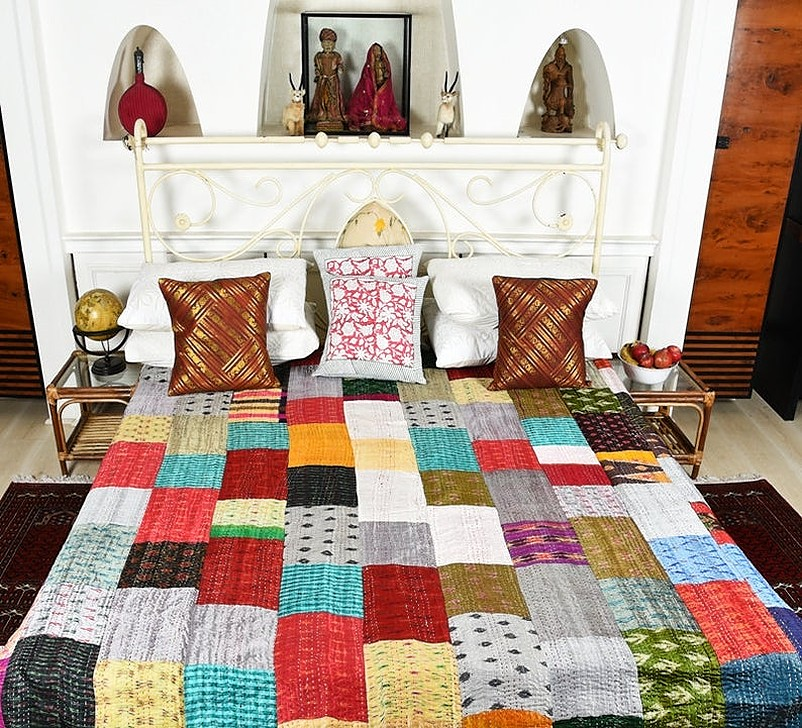Multi-colored silk printed bed with pillows and cushions