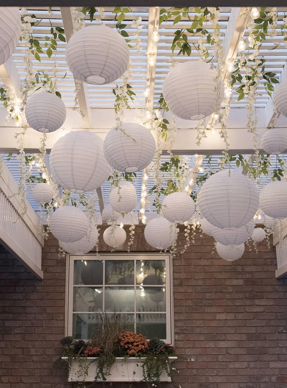 Paper Lanterns and Wisteria Under Pergola