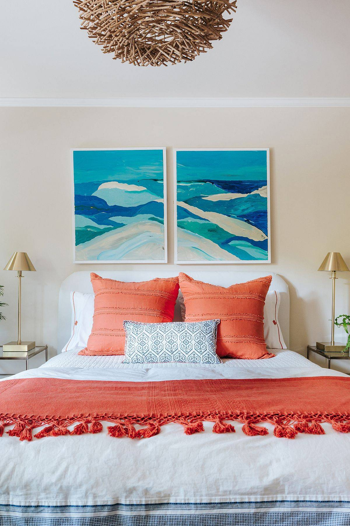 Picture-perfect beach style bedroom in beige with bright coral and blue accents