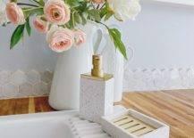Pink roses on white vase beside sink