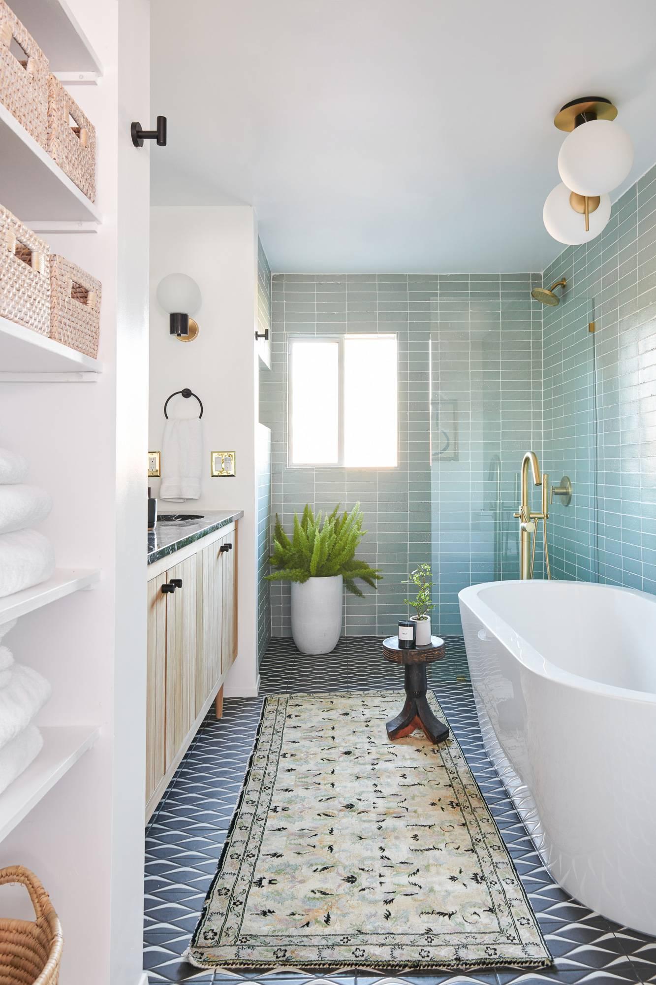 Potted plants beside bath tub