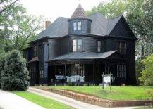 Rustic black house with a tower