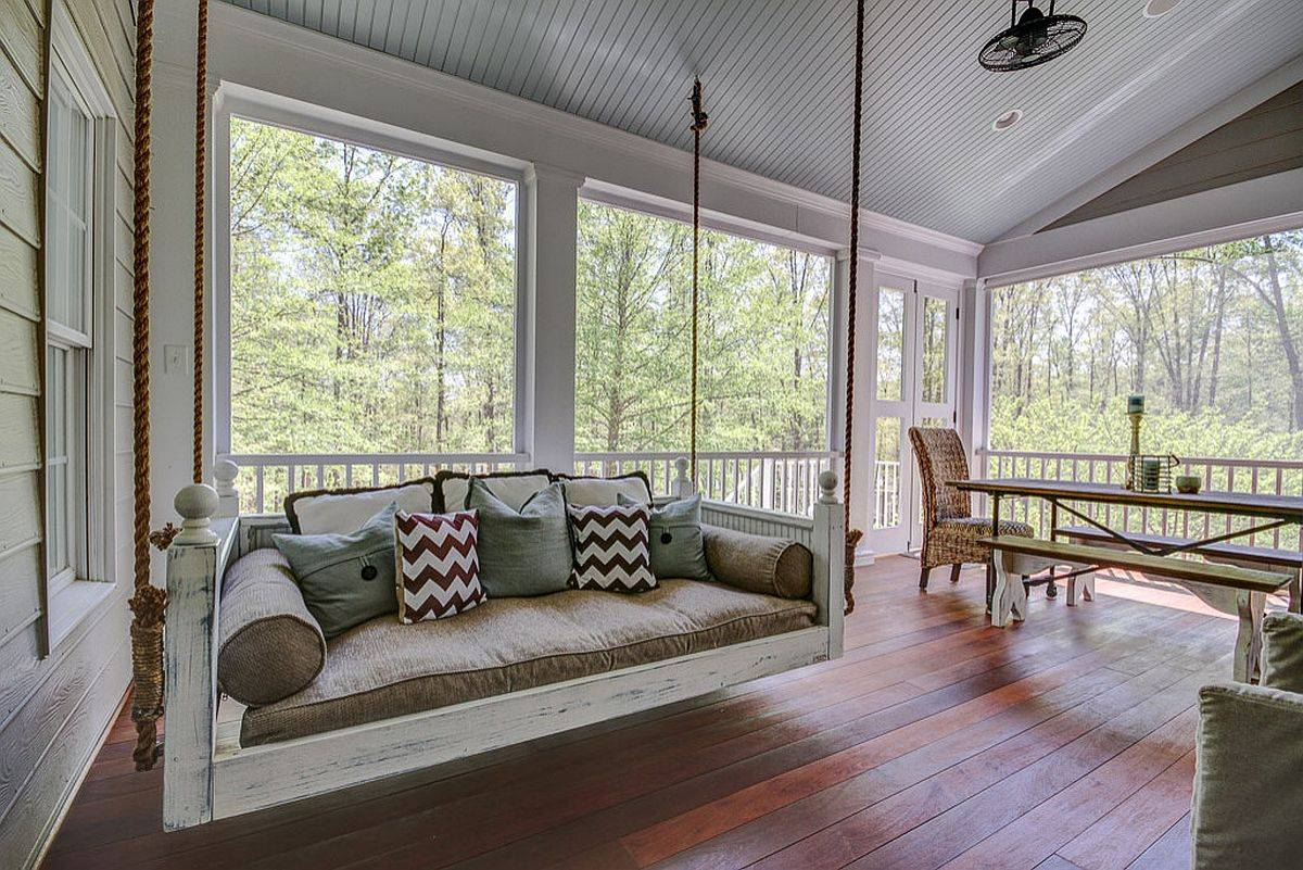 Shabby-chic-porch-with-fabulous-views-along-with-daybed-and-dining-table-is-just-perfect-for-a-staycation-27909