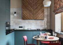 Small-contemporary-eat-in-kitchen-with-a-unique-wooden-cabinet-in-the-backdrop-39963-217x155