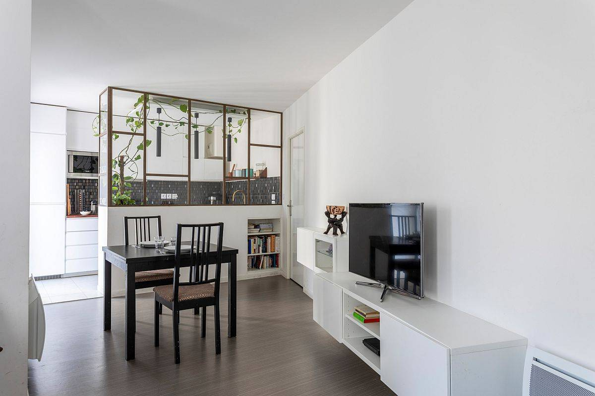 Smart custom partition delineates the kitchen from the small living and dining area while establishing visual contact