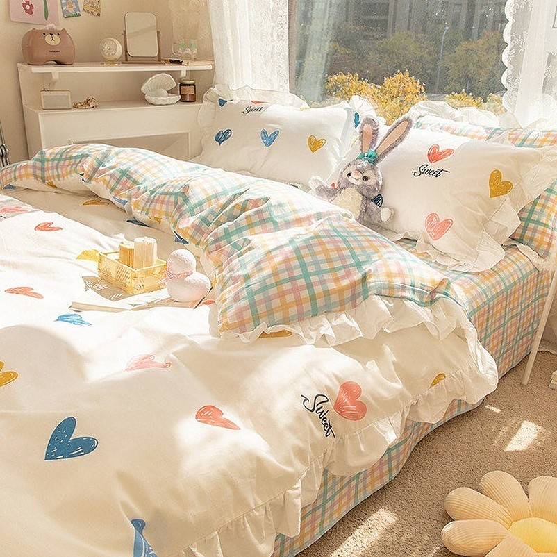 Stuffed rabbit on colorful bed