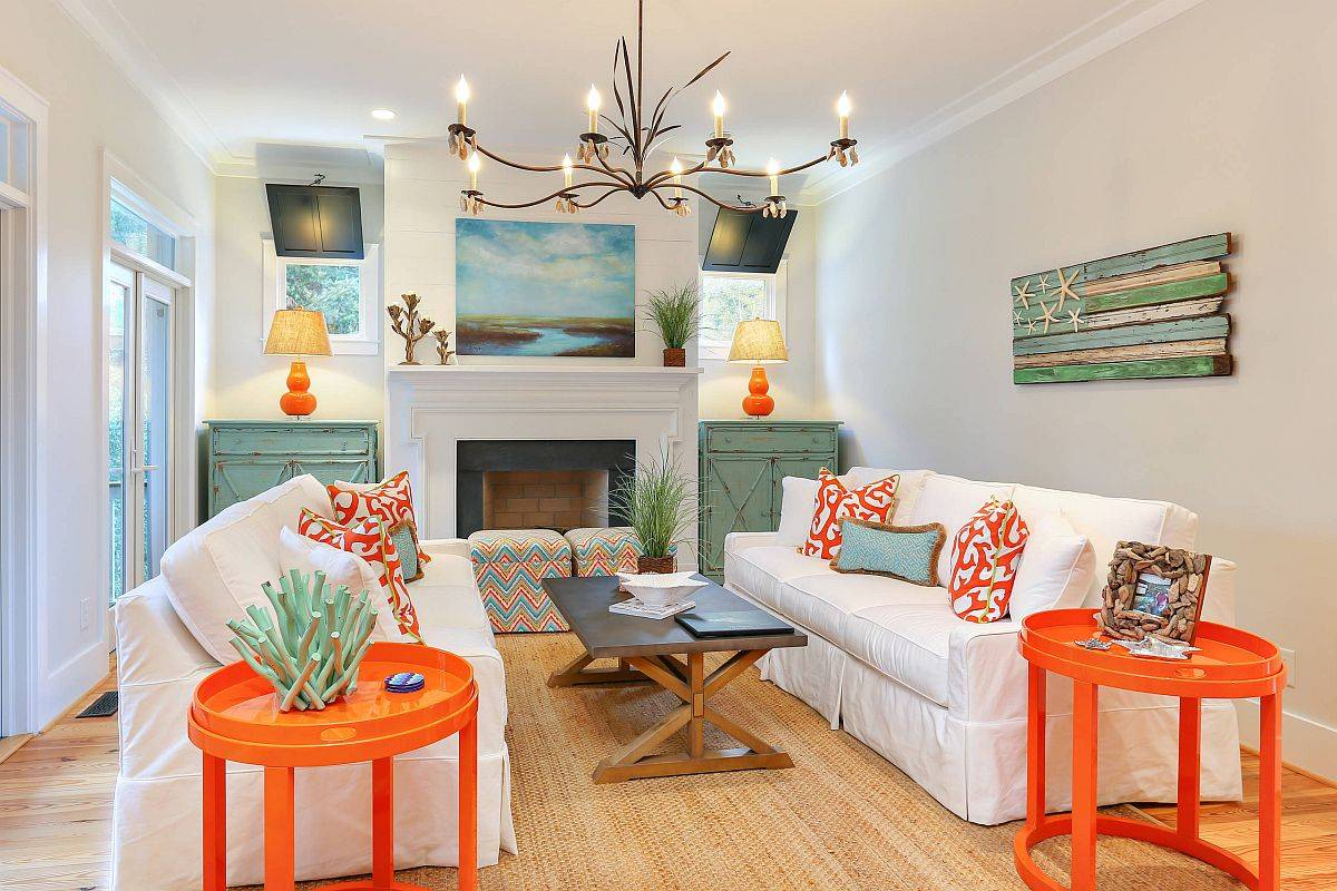 Stunning use of orange and blue accents in the small beach style living room