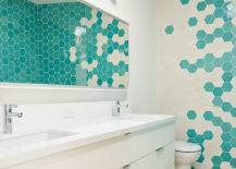 Turquoise and white hex tiles on bathroom wall