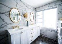 Two large mirrors and white double vanity inside bathroom