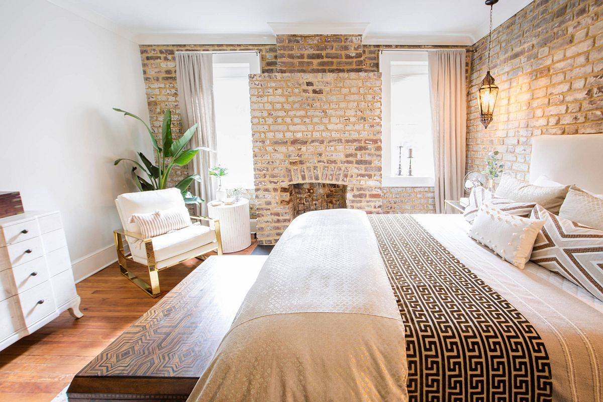 Vintage brick fireplace between the two windows makes an instant impact visually
