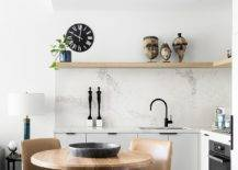 White-contemporary-kitchen-with-marble-backsplash-and-a-floaing-wooden-shelf-89893-217x155