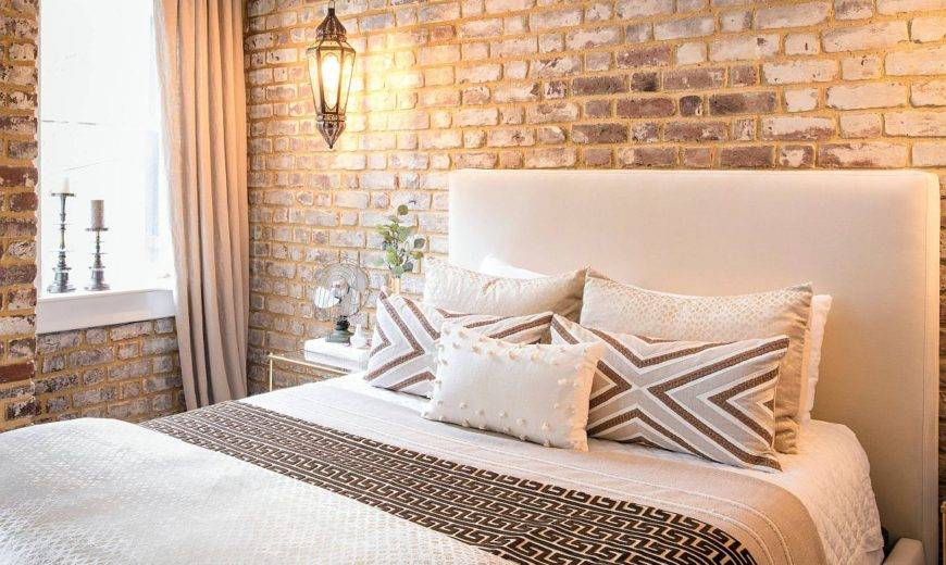 Rugged Modernity: Polished Industrial Bedroom with Exposed Brick Walls