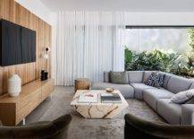 Wooden-accent-wall-entertainment-unit-marble-coffee-table-and-greenery-for-the-modern-family-room-54609-217x155