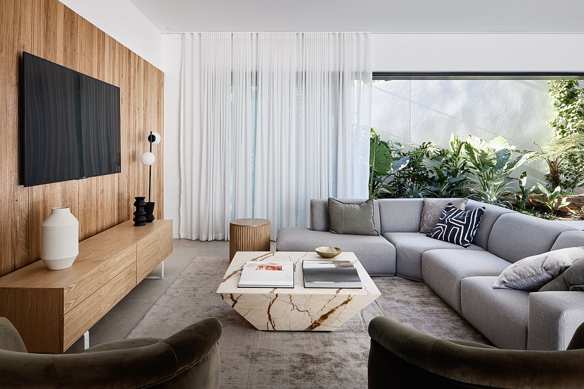 Wooden-accent-wall-entertainment-unit-marble-coffee-table-and-greenery-for-the-modern-family-room-54609