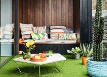 faux grass on balcony with colorful furniture