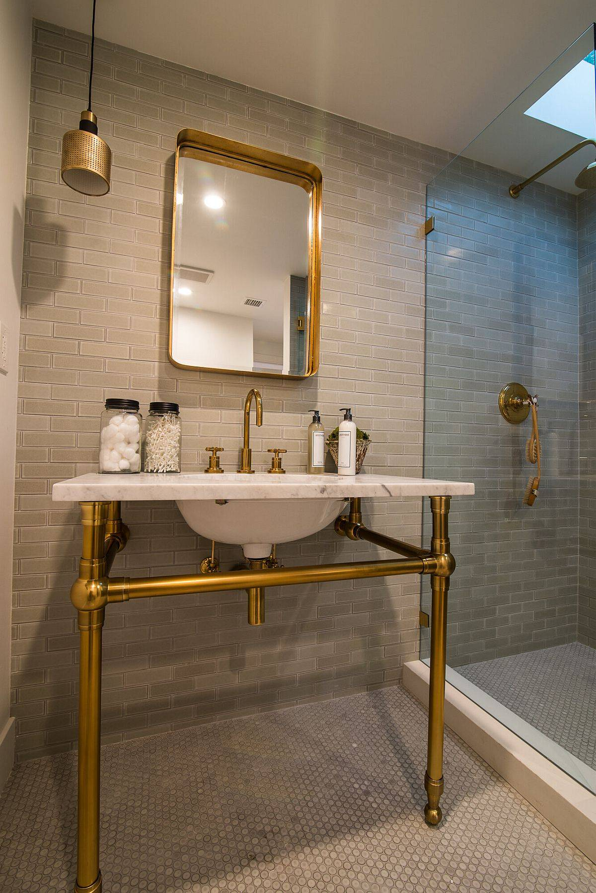 Bathroom with Spanish tile and sink that fetaures a gold base