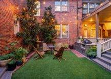 Beautiful-green-courtyard-with-brick-walls-in-the-backdrop-and-sparkling-lighting-looks-just-picture-perfect-94632-217x155