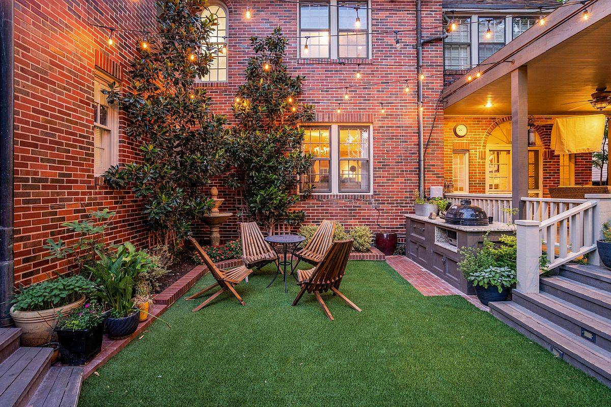 Beautiful-green-courtyard-with-brick-walls-in-the-backdrop-and-sparkling-lighting-looks-just-picture-perfect-94632