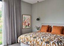 Bedding-and-accent-pillows-in-orange-bring-tropical-flavor-to-this-gray-bedroom-34508-217x155