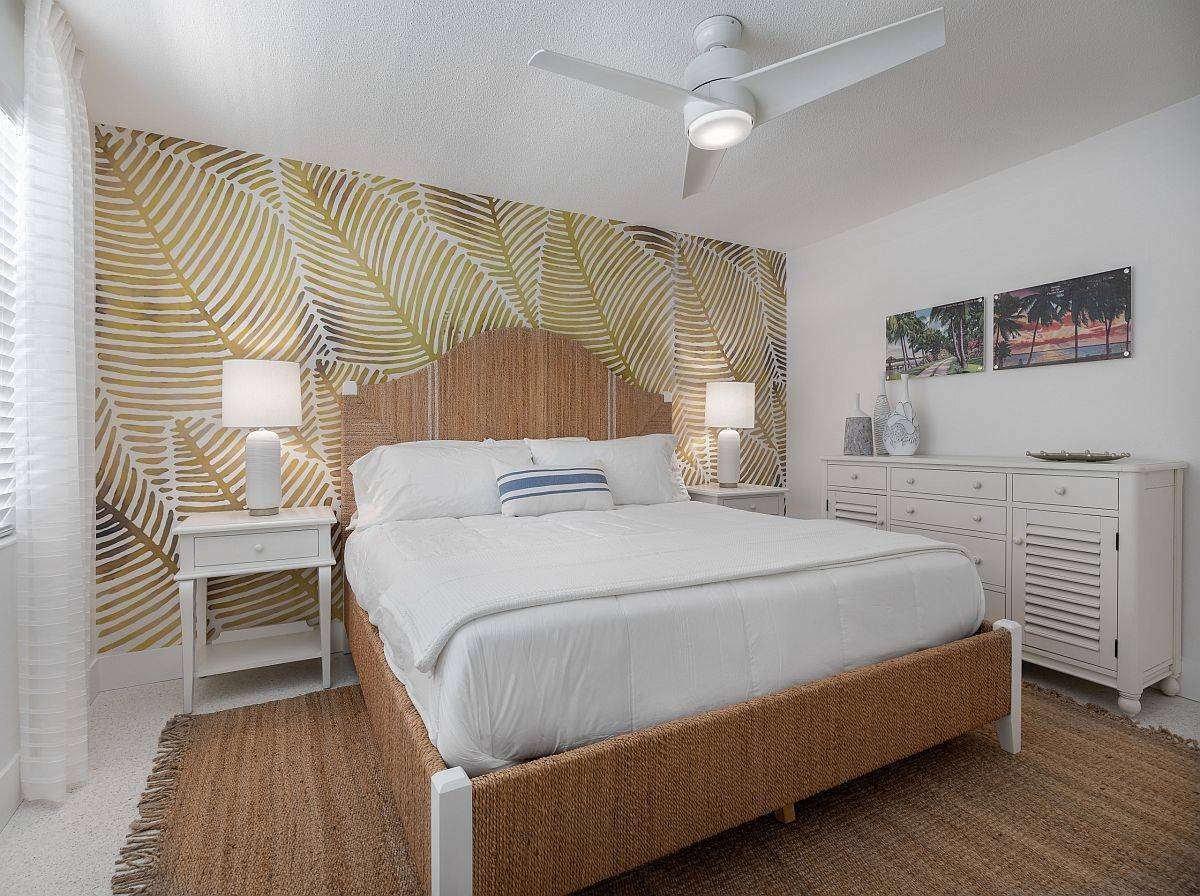 Bespoke-wallpaper-with-leafy-pattern-for-the-headboard-wall-brings-coastal-vibe-to-the-small-bedroom-13821