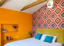 Bright-orange-and-pattern-filled-pink-wall-make-an-impression-in-this-small-bedroom-96931-217x155