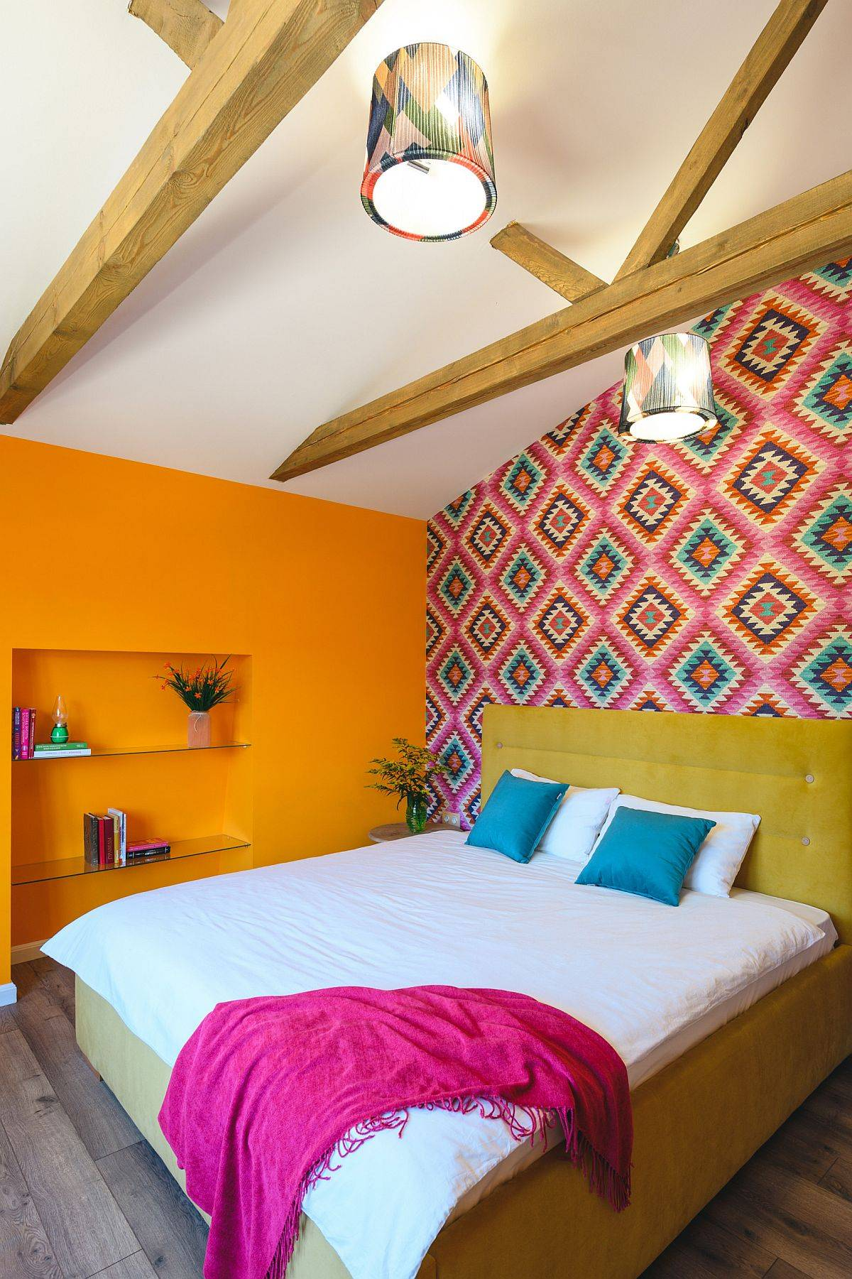 Bright-orange-and-pattern-filled-pink-wall-make-an-impression-in-this-small-bedroom-96931