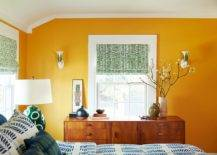 Captivating-yellow-accent-wall-coupled-with-green-blinds-and-blue-bedding-in-the-eclctic-bedroom-98219-217x155